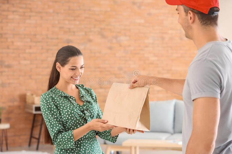 Man delivering food to customer indoors royalty free stock image
