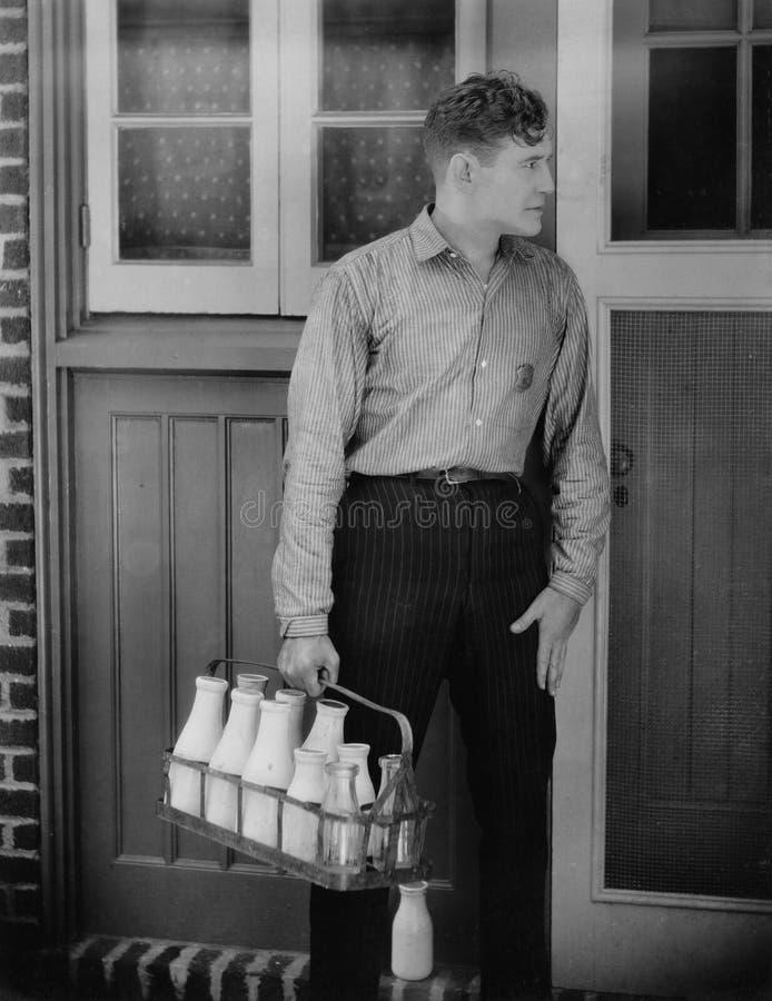 Man delivering milk stock images