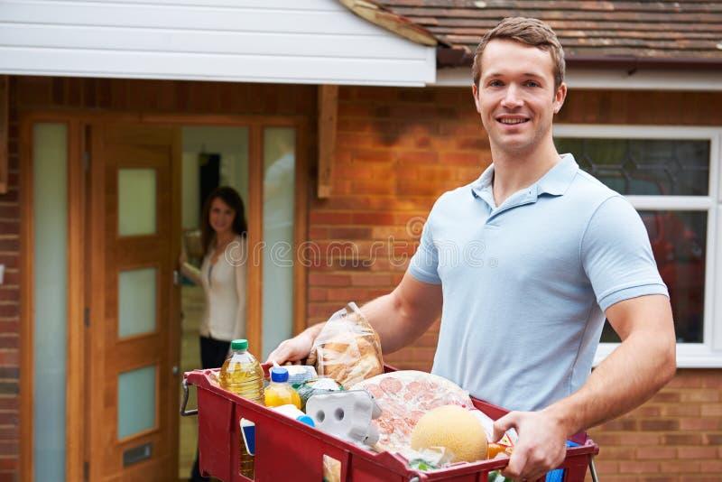 Man Delivering Online Grocery Order royalty free stock image