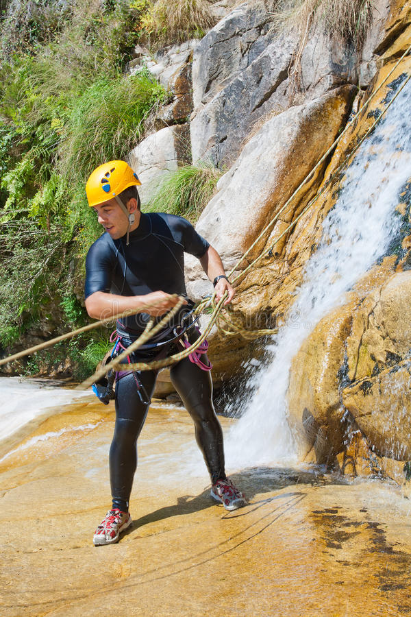 Download Man Descending Waterfall stock image. Image of system - 21583709