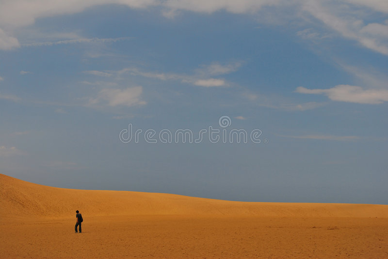 Man in desert stock photo