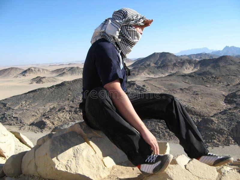 Man in desert with keffiyeh royalty free stock photos