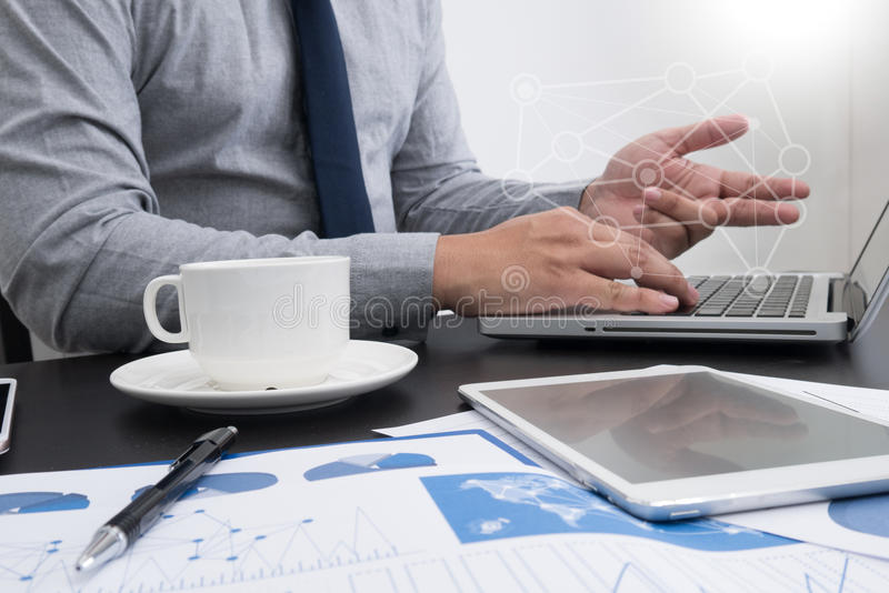 Man designer working digital tablet and smartphone and digital d. Man designer working digital tablet and smartphone and digital royalty free stock image