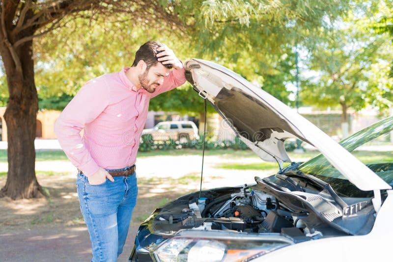 Man In Despair Looking At Broken Car stock images