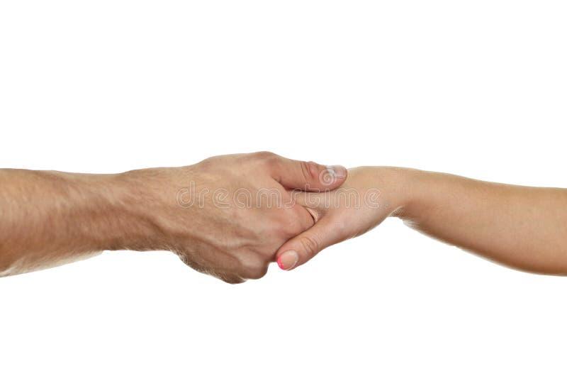Man die tactvol de hand van de vrouw schudt. royalty-vrije stock afbeelding