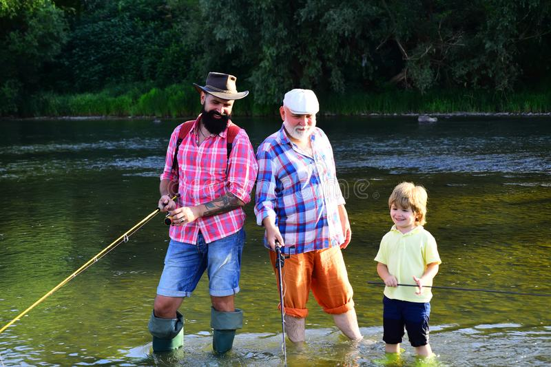 Man in different ages. Father and son fishing. Happy fisherman with fishing rod. Hobby and sport activity. Anglers. royalty free stock image
