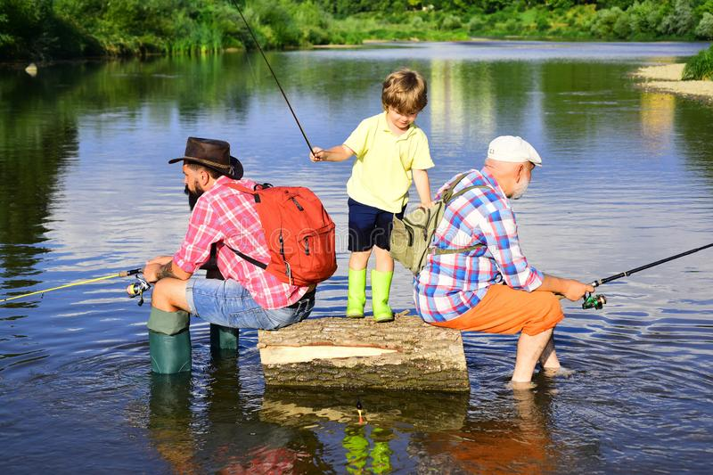 Man in different ages. Father and son fishing. Happy fisherman with fishing rod. Hobby and sport activity. Anglers. royalty free stock photo