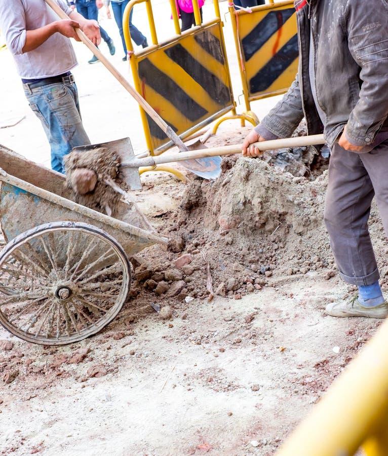 Man dig dirt at construction site stock photos