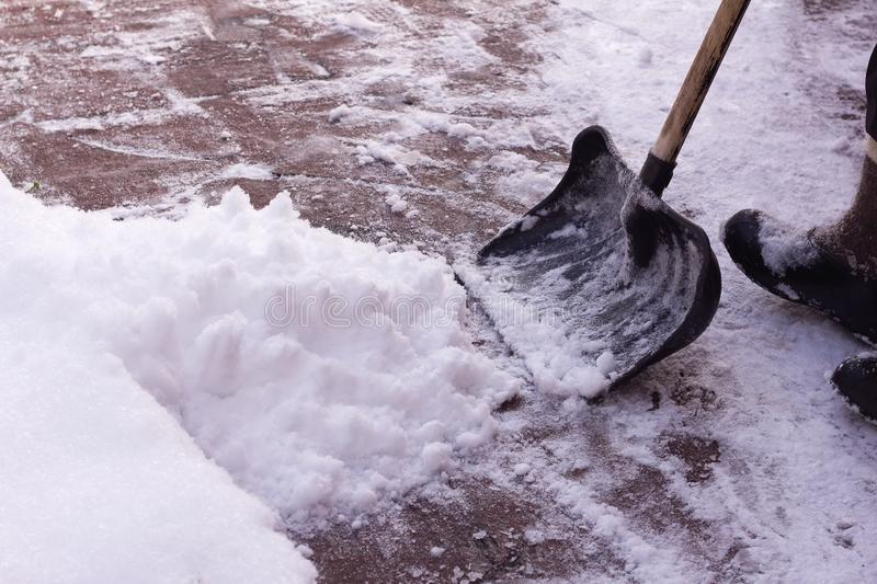 Man digging a path from the snow royalty free stock images