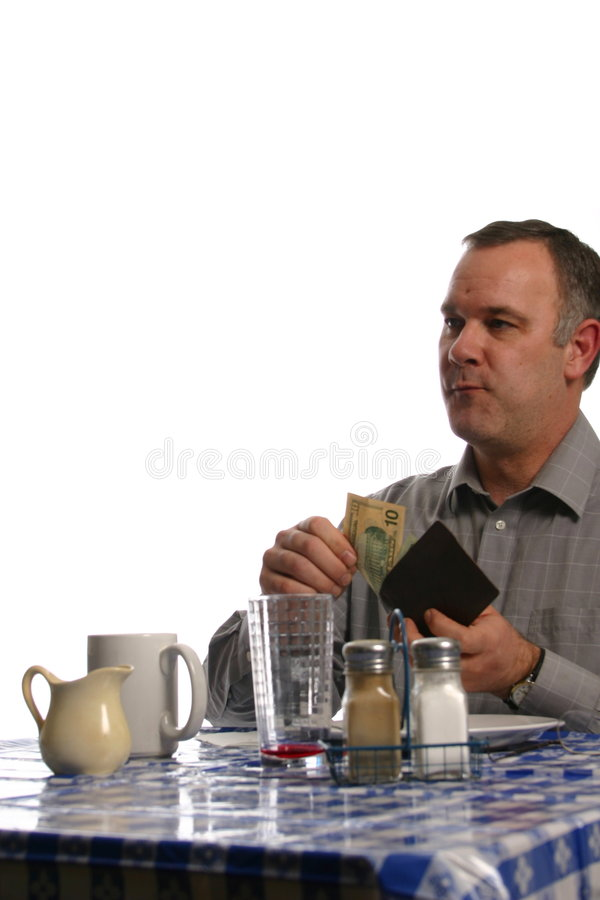 Man in diner paying bill royalty free stock image