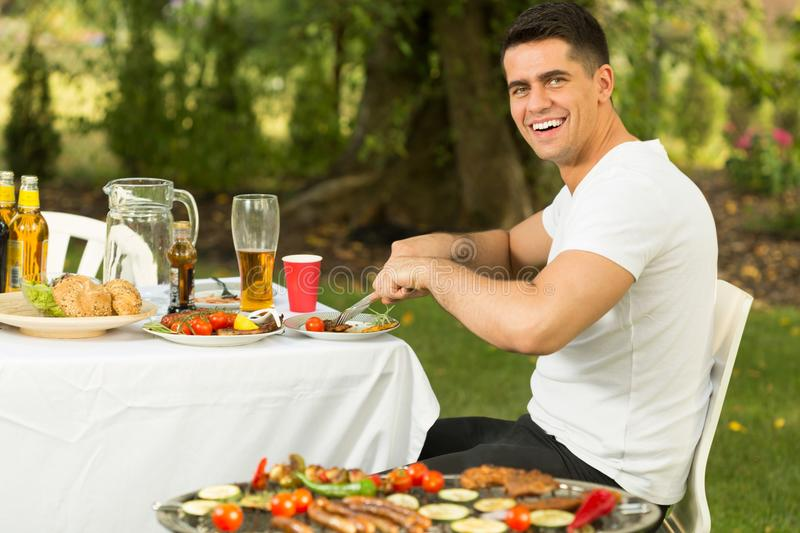 Man and dinner outside royalty free stock image