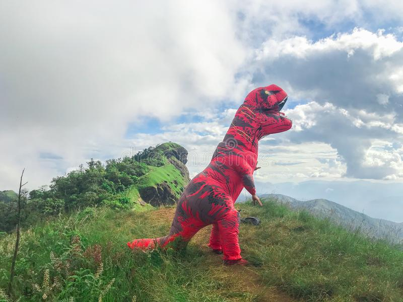 Man in dinosaur costume on top of the mountain at Chaing mai. Thailand stock photos
