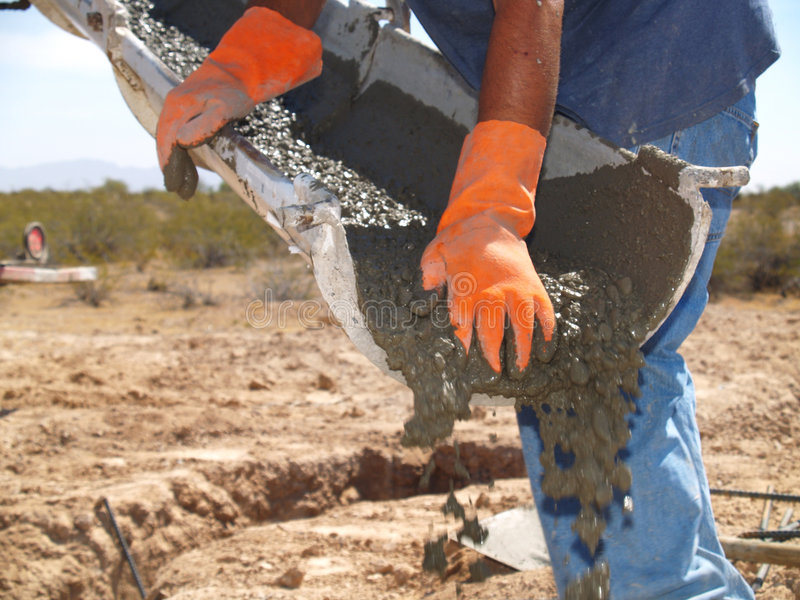Man Directing Cement From Spout - Horizontal stock photography