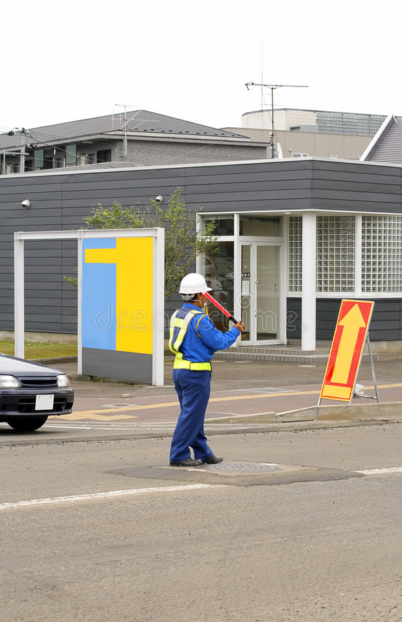 Man directing traffic 2 royalty free stock images