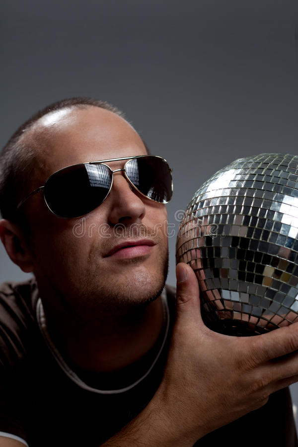 Download Man with disco ball stock image. Image of posing, style - 21968493