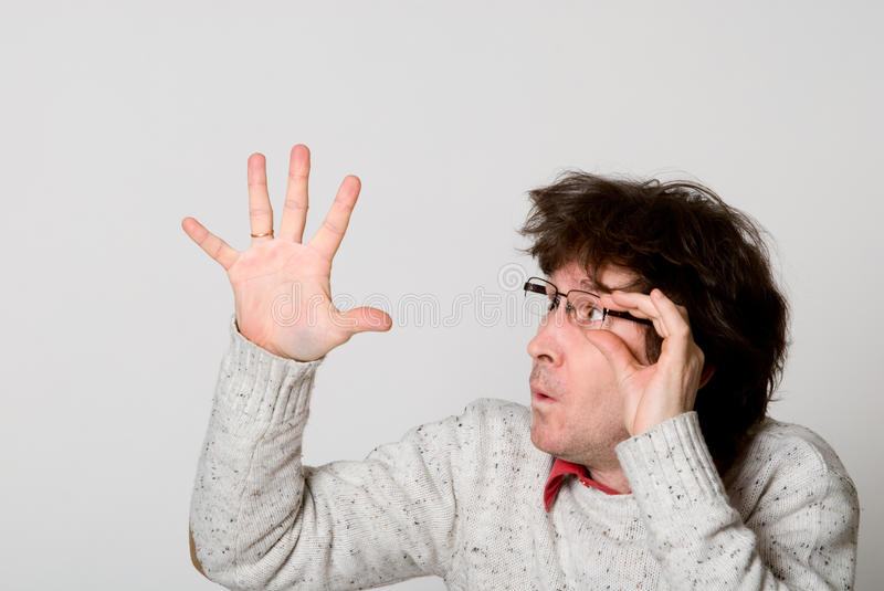 Download Man With Disheveled Hair Pointing  Hand At Something Interesting Stock Photo - Image: 28755468
