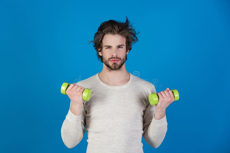 Man with disheveled hair in underwear training with barbell, morning. Man with disheveled hair in underwear training with barbell after wake up in morning, sport royalty free stock photography