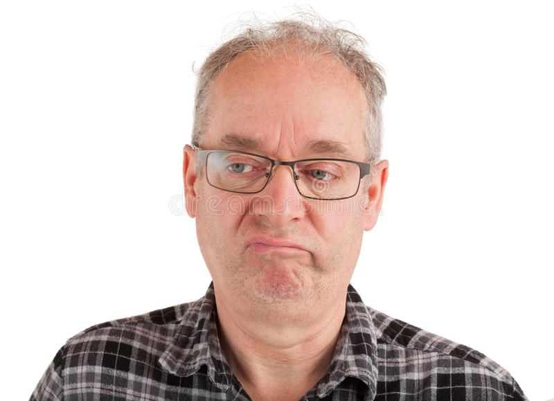 Man is Displeased about Something. Man is annoyed about something royalty free stock photography