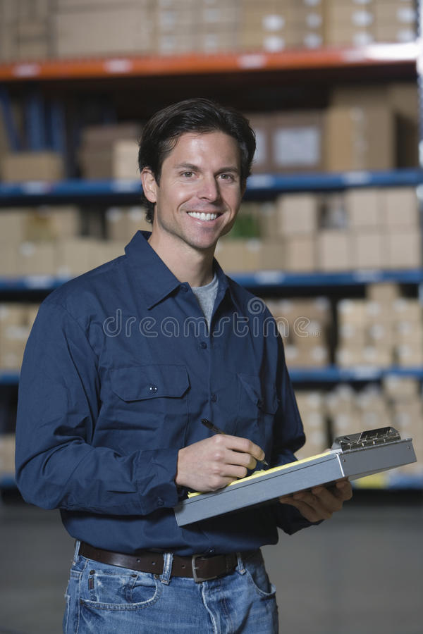 Man In Distribution Warehouse royalty free stock photography