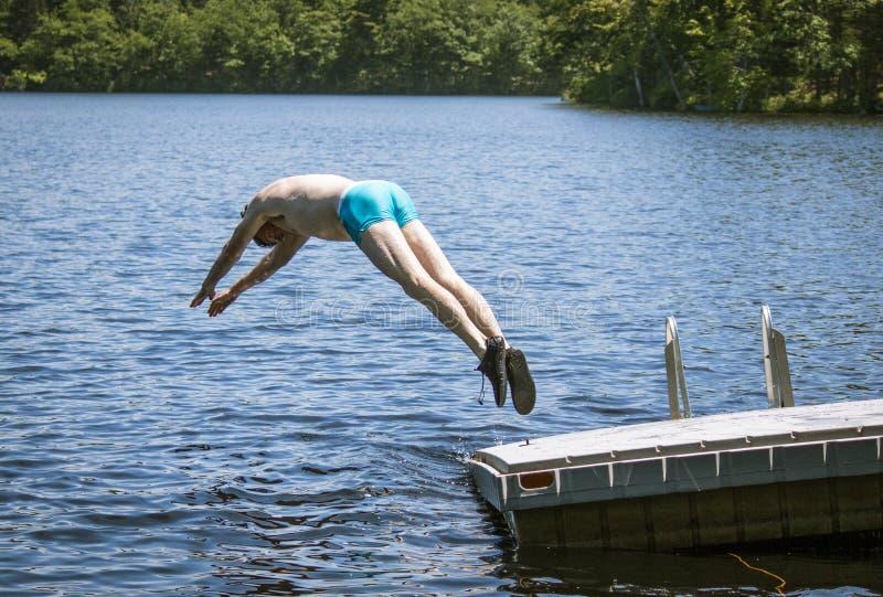 Man diving into lake royalty free stock photo