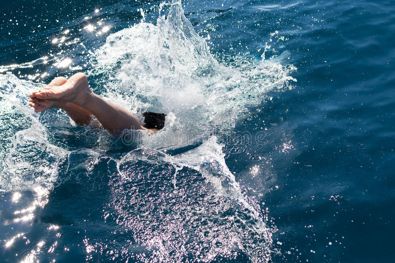 Man diving into the sea stock photo
