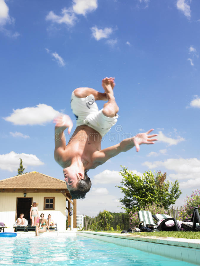 Download Man Diving Into Swimming Pool Stock Photography - Image: 12052912