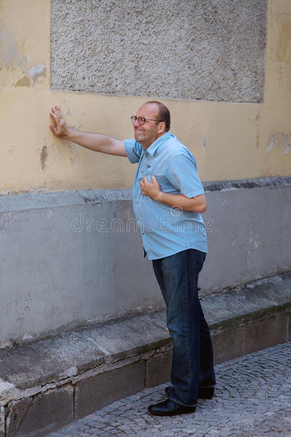 Man dizziness or heart attack stock image