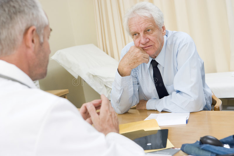 Man in doctor's office stock image
