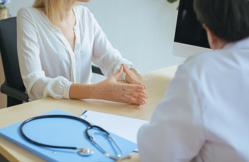 Man doctor talking and examining to woman patient,Infertility counseling and suggestion using new technology stock photo
