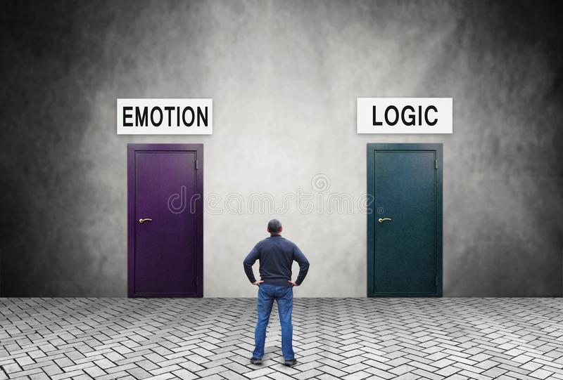 Man does not know what to choose Logic or Emotion. Man stands in front of two doors and does not know what to choose Logic or Emotion royalty free stock photos