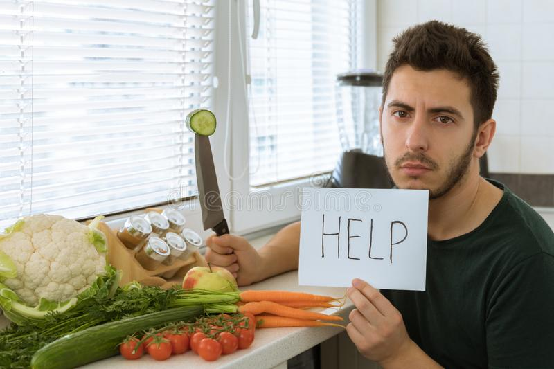 Conceptual photo about dependence on not healthy food. Man does not like to eat vegetables, he asks to help him. Conceptual photo about dependence on not royalty free stock photo