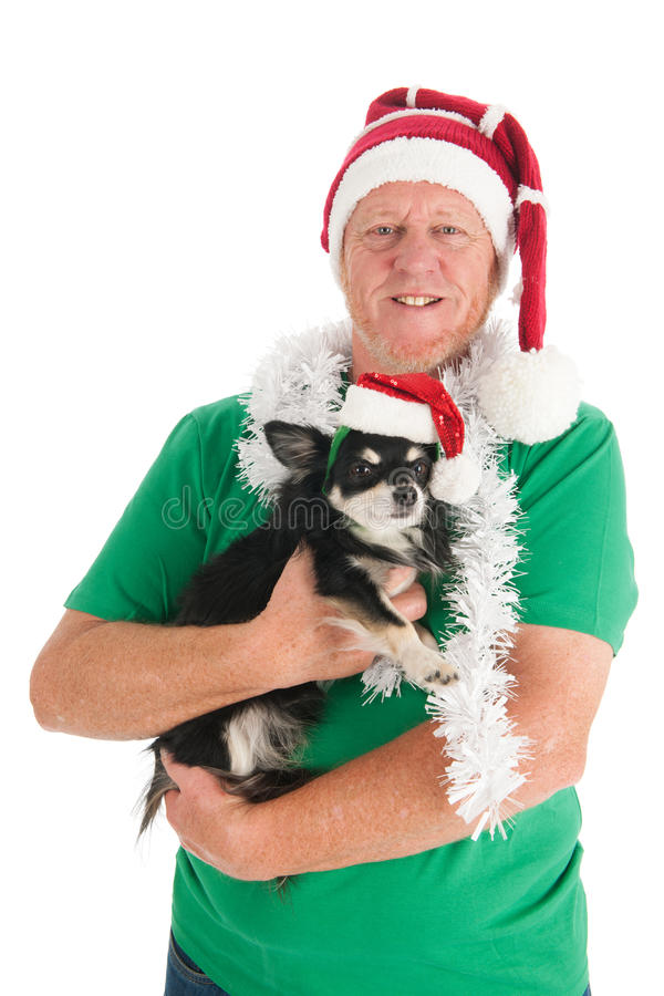 Man with dog as Santa Claus. Man with his little dog for Christmas isolated over white background royalty free stock photo