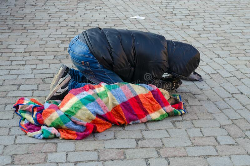Man with dog is asking for alms on street of Prague, Czech Republic stock photo