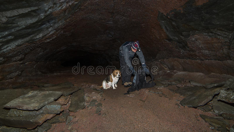 Download A man and a dog in a cave. stock image. Image of equipment - 28881447