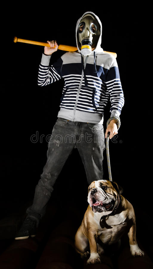 Man and dog. A man with a gas mask and a dog royalty free stock photography