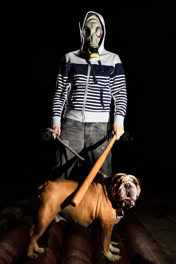Man and dog. A man with a gas mask and a dog royalty free stock images