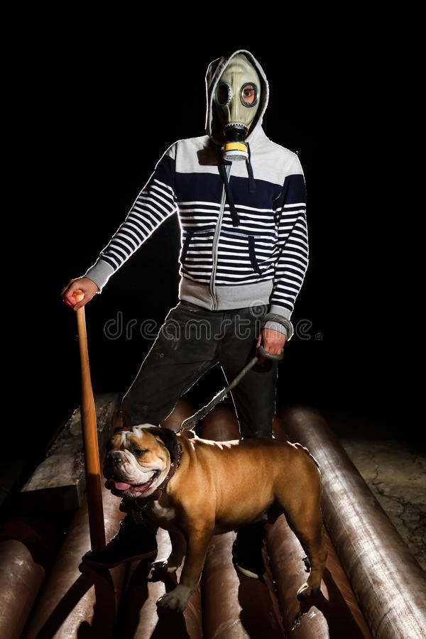 Man and dog. A man with a gas mask and a dog stock photography