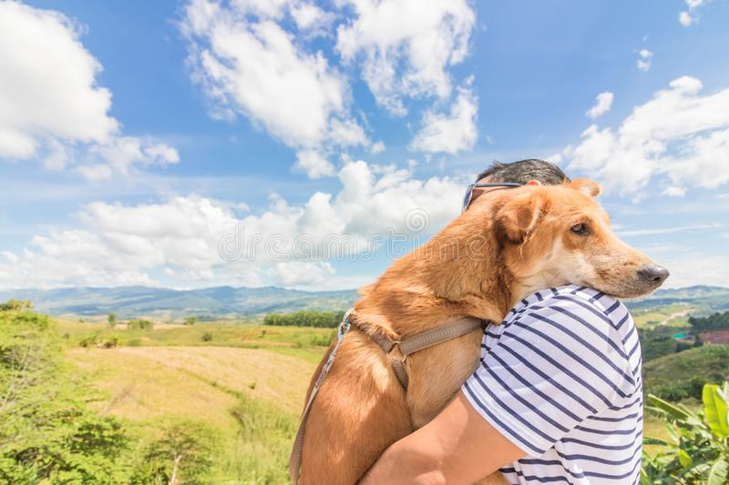 A man with  dog. mountain and blue sky and very nice clouds. A man with a dog. mountain and blue sky and very nice clouds stock photos
