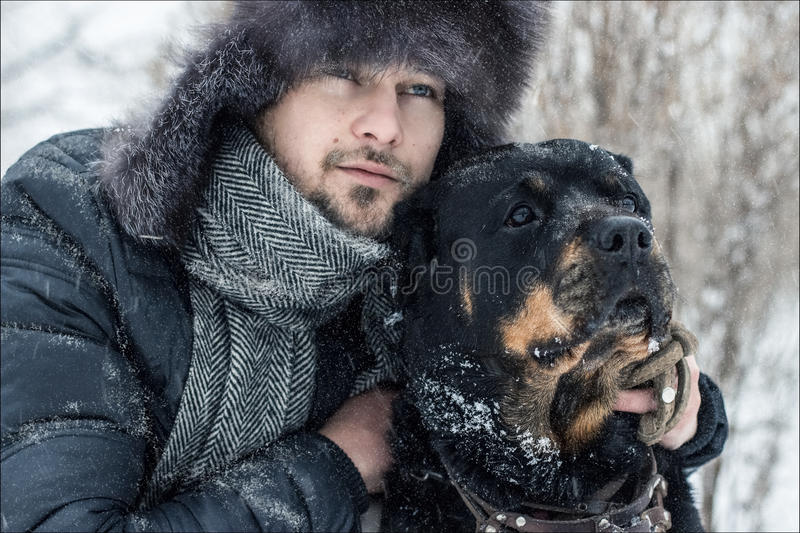 Man and dog in the snow royalty free stock photos