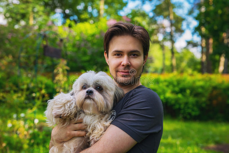 Man with dog stock photos