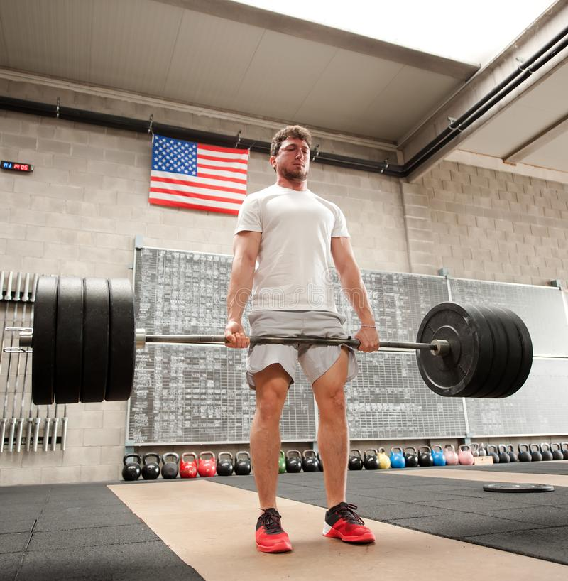 Man doing deadlift exercise, from low angle royalty free stock photography