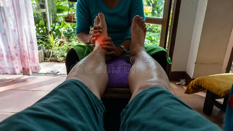 A man doing foot massage, a Thai massage in a place in Chiang Mai, stock images
