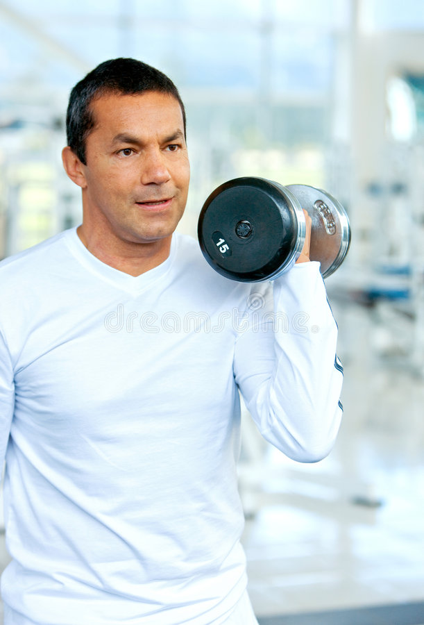 Download Man doing free weights stock photo. Image of american - 6548558