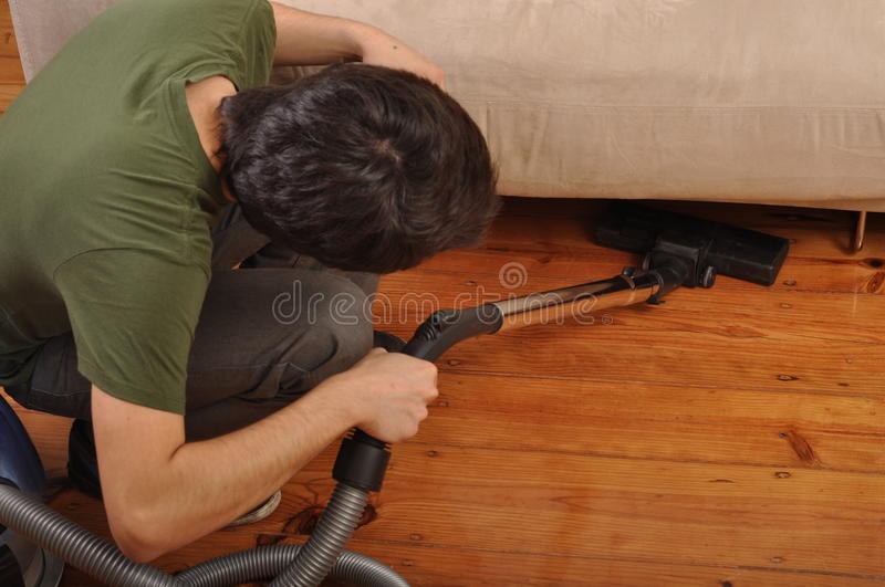 Man Doing The Housework Stock Images