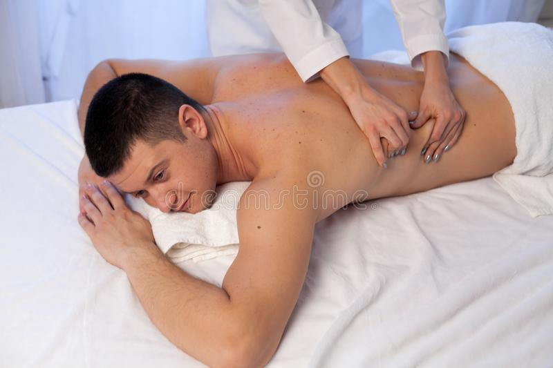 Man doing medical massage hands person in Spa stock image