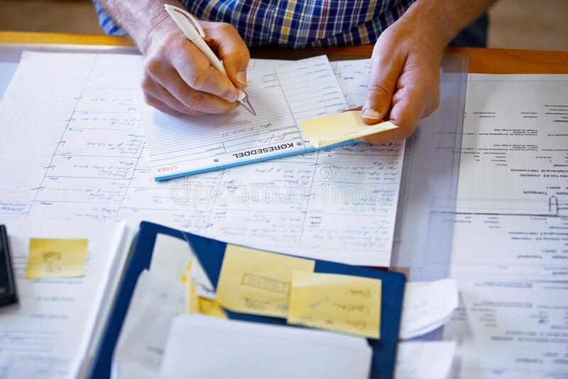 Man doing paperwork royalty free stock photo