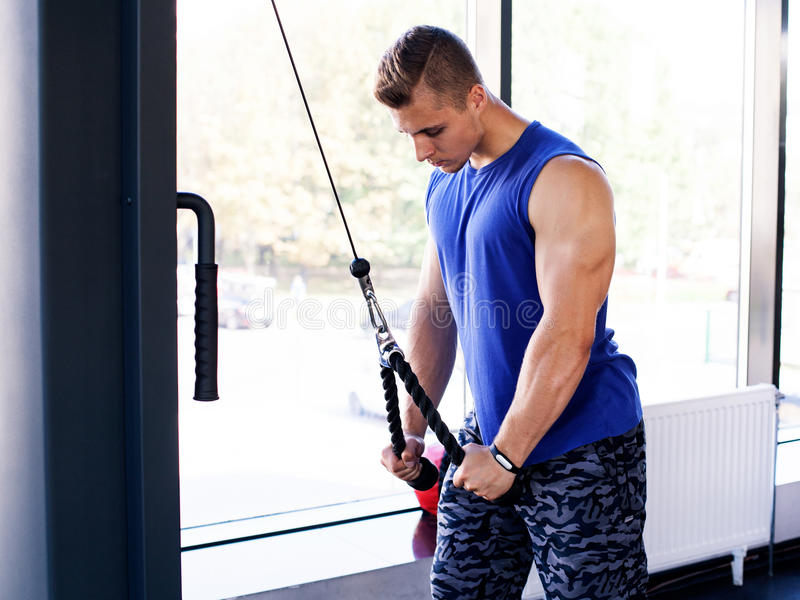man doing pull down exercise for triceps royalty free stock image