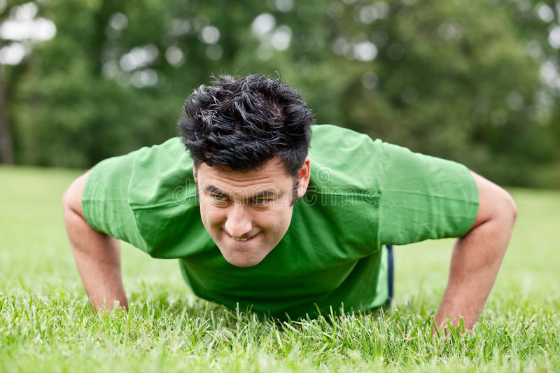 Download Man doing push ups stock image. Image of working, activity - 22494197