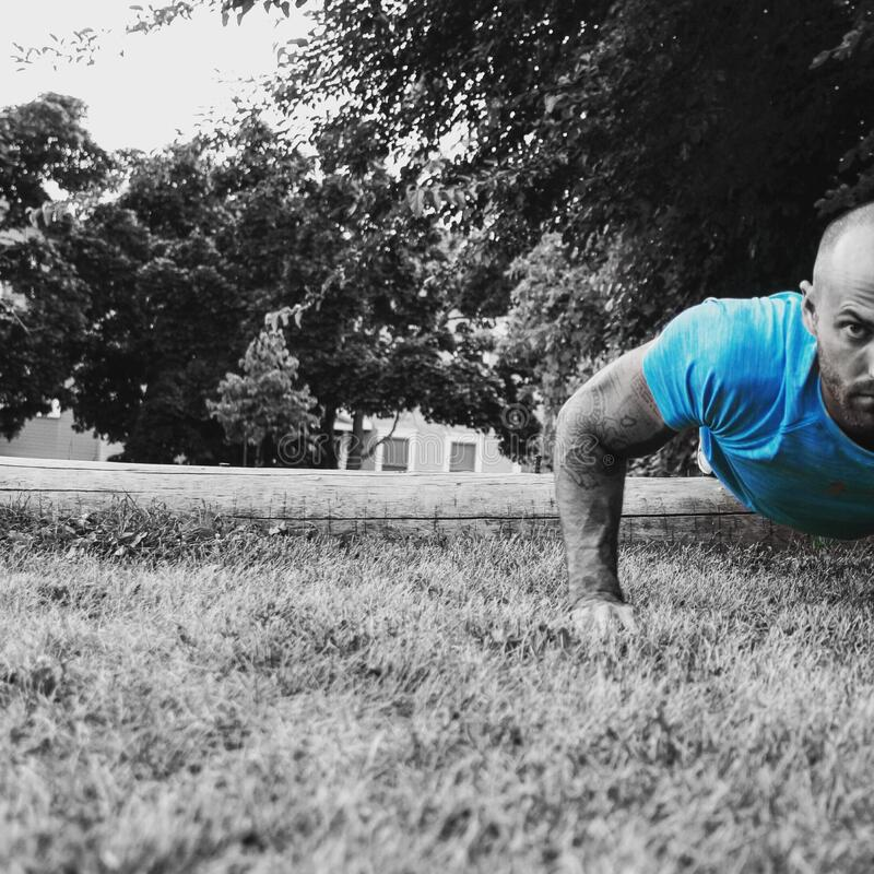 Man doing push ups stock photo