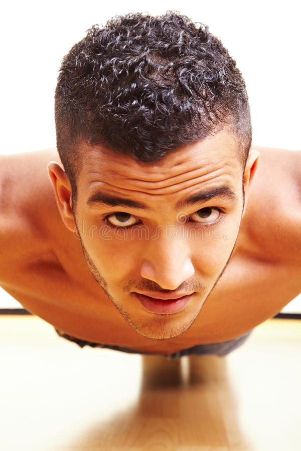 Download Man doing pushups stock image. Image of fitness, frontal - 12958147